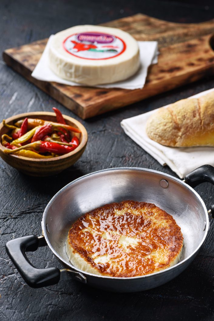 Mastelo Saganaki with red hot peppers
