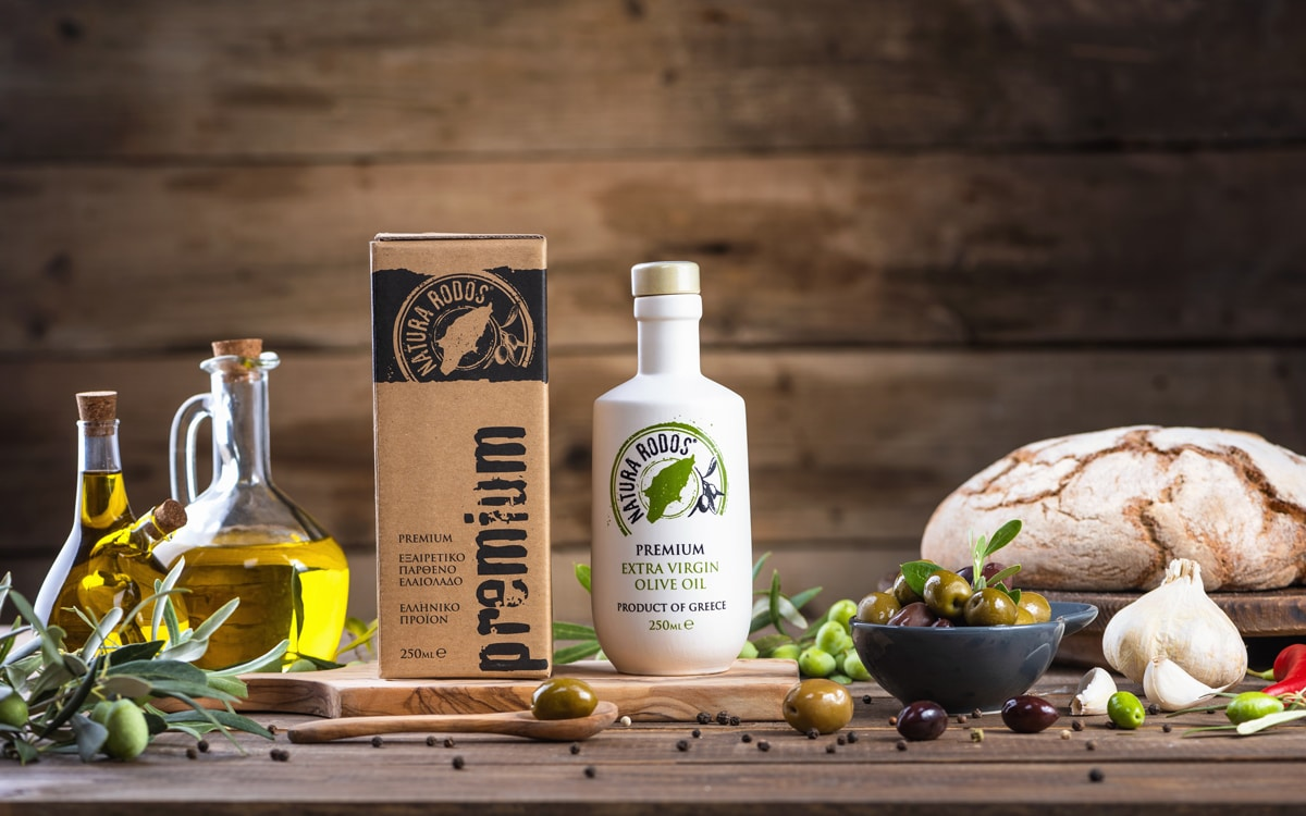 Premium Greek extra virgin olive oil on wood