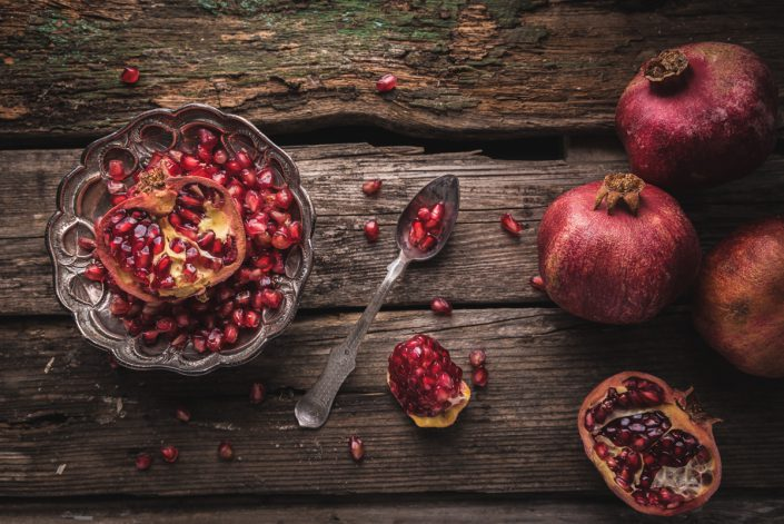 pomegranate with a spoon