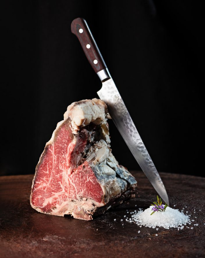 dry aged steak on wood
