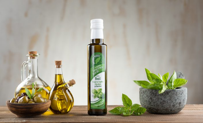 Extra virgin olive oil with Basil on wood